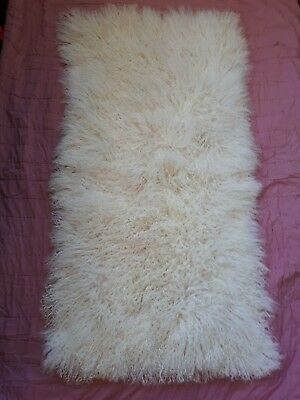 Tibetan cream rectangular lambskin rug/throw. Size 120 x 60cms.