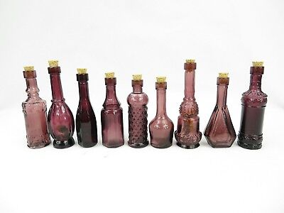 Antique lot of miniature purple bottles w/cork for flowers or perfume pharmacy