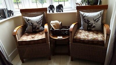 Matching pair of good quality wicker armchairs with embroidered gold and...