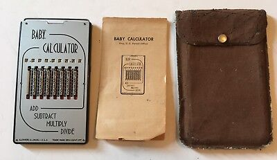 vintage Baby Calculator, orig. faux leather case, and instructions