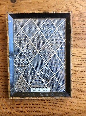 antique lace sampler from around 1750 with marquetry frame possibly the original