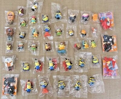 HUGE LOT of MINIONS FIGURES From DESPICABLE ME MOVIE most are in UNOPENED PACKS