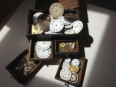 Old enamel clock faces in box.