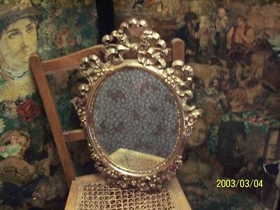 A large, vintage, hard plastic mirror. veronese product. made in england.