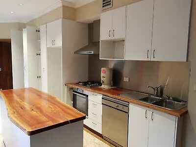 Kitchen second hand polyurethane filled timber benchtops smeg cooker and d/washe