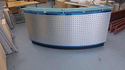 Reception Desk very modern ,fitted with blue lights ,metal grid on front.