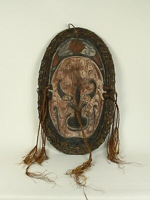 A Mid 20th Century Lower Sepik Region Carved Wood Wall Mask, Papua New Guinea.