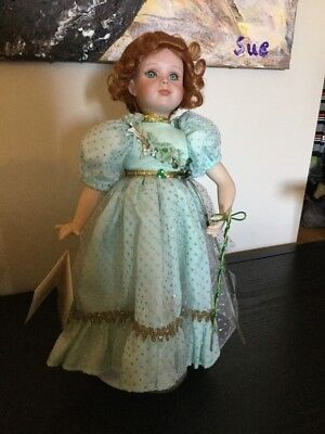 Porcelain doll Paradise Galleries. 13inch. with stand.