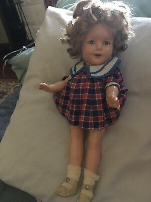 13 inch Shirley temple tagged school girl dress in good condition.