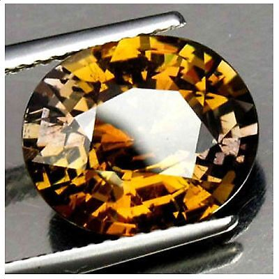 Tanzanite, Certified, Yellow- brown, Unheated, VVS,5.85 carats, compare prices!