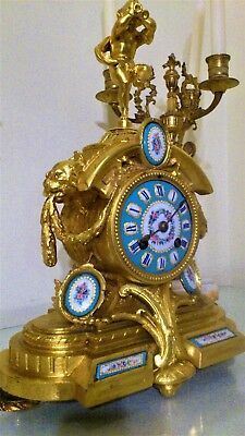 Antique French Gilt Figural Mantel Clock with Sevres Porcelain Panels.