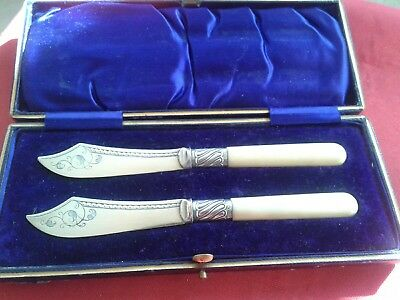 Lovely antique cased silver plate butter spreaders, sterling silver collars .