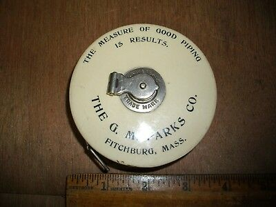 O527  Antique Advertising Cloth Tape Measure Tailor