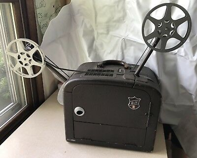 BELL & HOWELL 185 16mm SOUND PROJECTOR IN GREAT WORKING CONDITION Movie 2 Reels