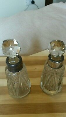 A pair of silver necked scent bottles