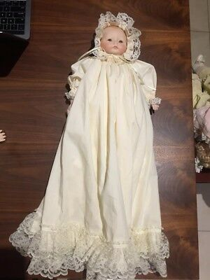 Porcelain baby in long dress with bonnet.
