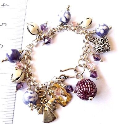 925 Sterling Silver Plated Charm Bracelet With angel themed Charms
