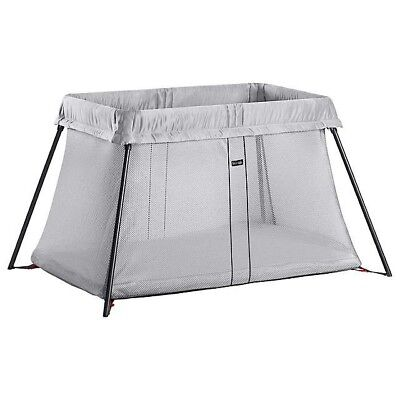 Brand new Baby Bjorn travel cot light with brand new cot sheet included