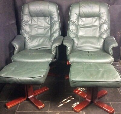 A Pair of Good  Quality Green Leather Swivel Reclining Chairs, Matching Stools