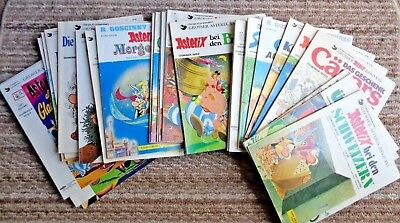 30 Asterix and Obelix paperback comic books in German. Excellent condition