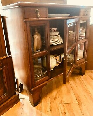 Glass fronted cabinet.