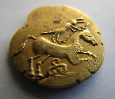 Celtic Gold Coin.1/4 Stater, gold.Triskelis below Horse and on reverse(1,94 gr.)