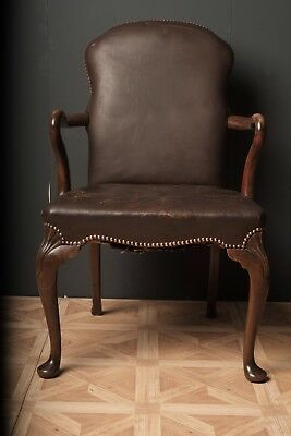 Antique studded leather armchair