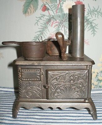 """TINY EARLY 1900s """"48"""" Cast Iron Toy Stove, J & E Stevens, Antique Lacquered Iron"""