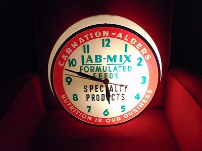 Vintage Carnation Albers Lab-Mix Advertising Lighted Clock by Dualite