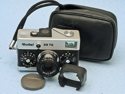 Rollei 35T in nice condition, with case, strap, solid lens hood, cap, original.