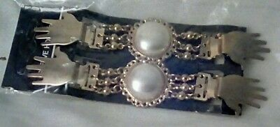 Vintage sleeve holders. Faux pearls with hand shape clasps.