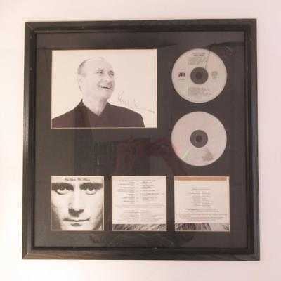Framed Music Memorabilia Phil Collins CD Face Value with Hand Signed Photograph