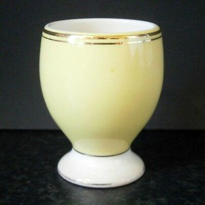 VINTAGE ROMANIAN CHINA YELLOW EGG CUP with GOLD RIM