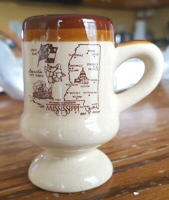 "Mississippi souvenir ceramic cup, vintage, 3 1/8"" tall, 1 3/4"" base, tan, brown"