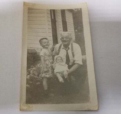 Found Photo: 1950's Proud Old Man, Child, and Baby Posed in Front of House