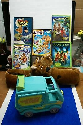 Lot of 7 Scooby Doo items: Slippers, Scooby Doo Vehicle and 5 DVD's