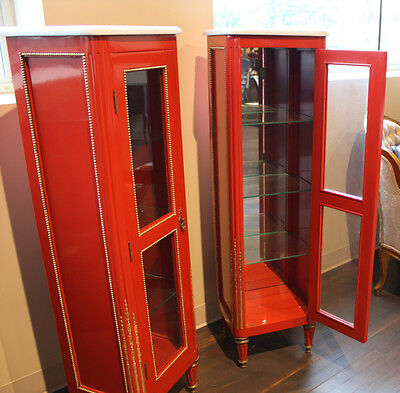 Pair of red vitrine showcases with marble tops, mirrored back, glass shelves