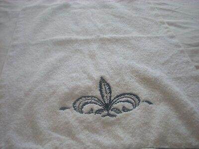 White cotton hand towel with Fleur de Lis and black accents