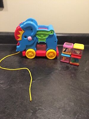 FISHER PRICE MUSICAL ROLLING ELEPHANT WITH 4 PEEK-A-BOO BLOCKS EUC Poppity Pop