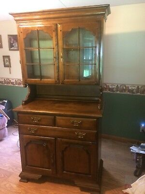 Two piece hutch ,two door front with glass and two shelves very nice!