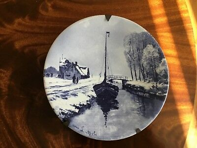 Antique Delft charger by L.Apol