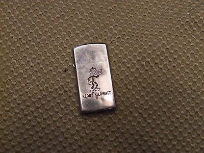 Vintage Slim Zippo Lighter Reddy Kilowatt NIB