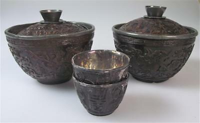 Pair Chinese 19th century silver lined carved coconut cups and covers