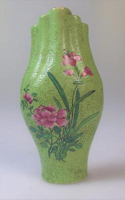 A beautiful Chinese lime green ground scrafitto early 19th century wall vase