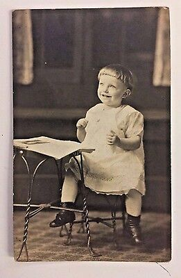 Vintage RPPC Postcard Laughing Smiling Baby Child Desk School Student Baby Photo
