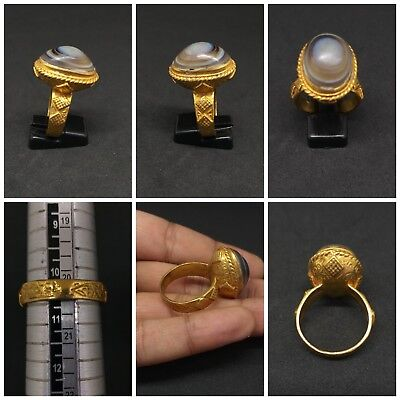 Gold gilded a wonderful old ring with evil eyes black agate