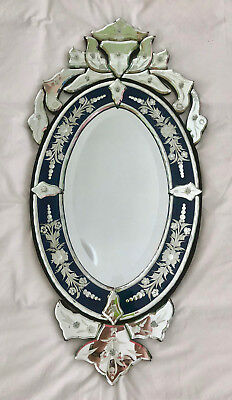 Venetian vintage mirror with an ornate blue and clear glass etched design