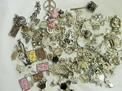 SMALL MIXED LOT OF ANTIQUE SILVER CHARMS AND PENDANTS Lot C