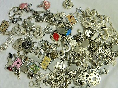 SMALL MIXED LOT OF ANTIQUE SILVER CHARMS AND PENDANTS Lot B