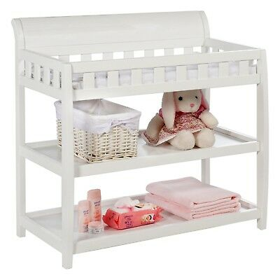 Wooden changing table with safety rails & storage and comes with pad & strap